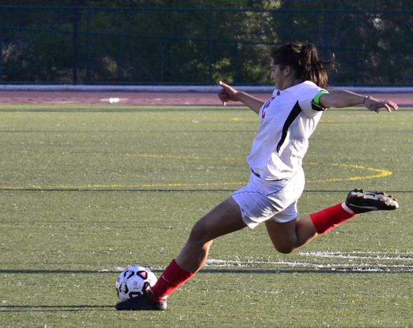 Forward Jackelyn Alarcon crosses the ball at Sartoris Field on Sept. 18. Despite her effort, the Lady Vaqs lost the game 1-0.