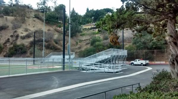 The historic clubhouse and stadium have been replaced with metal bleachers and open space.