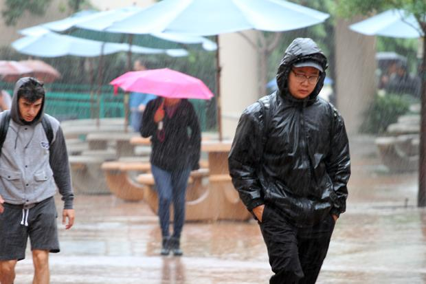 Students trudge through the rain to classes on Tues. Sept. 15, 2015 at Glendale Communityt College.