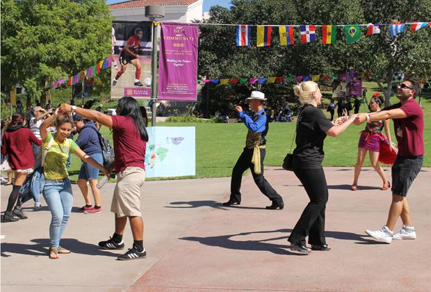 DANCERS DELIGHT:  Students join dancers Jorge Rivas, Viridiana Velasquez and Celestino Monje in Plaza Vaquero for the Hispanic Heritage Day celebration on Oct. 8.