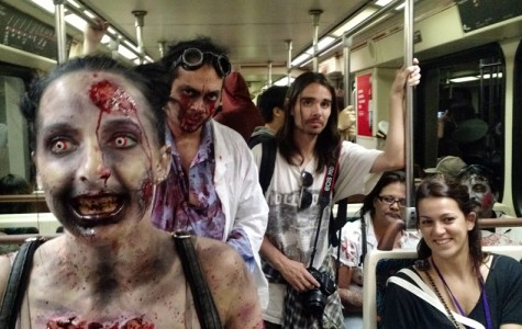 Corey Zicari and Ricardo Orta ride the Red Line train to Hollywood and Highland for the Hollywood Subway Zombie Walk on Sunday.