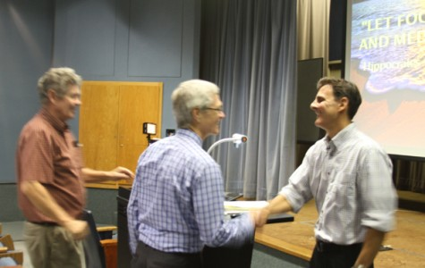 """FACULTY AWARD: President David Viar congratulates biology professor Joseph Beeman, recipient of the 28th Annual Distinguished Faculty Award, after his presentation, """"Blissful Eating, Compulsive Thinking: The Body-Brain Connection"""" in Kreider Hall Thursday."""