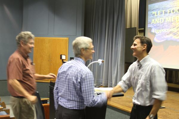 "FACULTY AWARD: President David Viar congratulates biology professor Joseph Beeman, recipient of the 28th Annual Distinguished Faculty Award, after his presentation, ""Blissful Eating, Compulsive Thinking: The Body-Brain Connection"" in Kreider Hall Thursday."