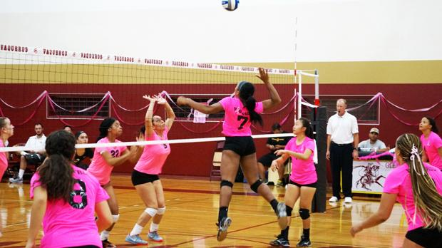 LADY VAQS: Dominique Hall leaps into the air to spike the ball. The Lady Vaqs faced the Antelope Valley Marauders in Verdugo Gym on Oct. 30.