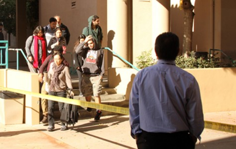 Students and faculty evacuate the Arroyo Seco building after a suspicious package was found yesterday.