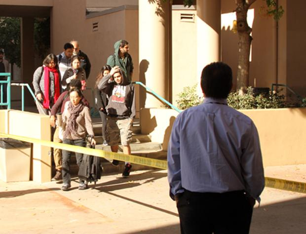 Students+and+faculty+evacuate+the+Arroyo+Seco+building+after+a+suspicious+package+was+found+yesterday.