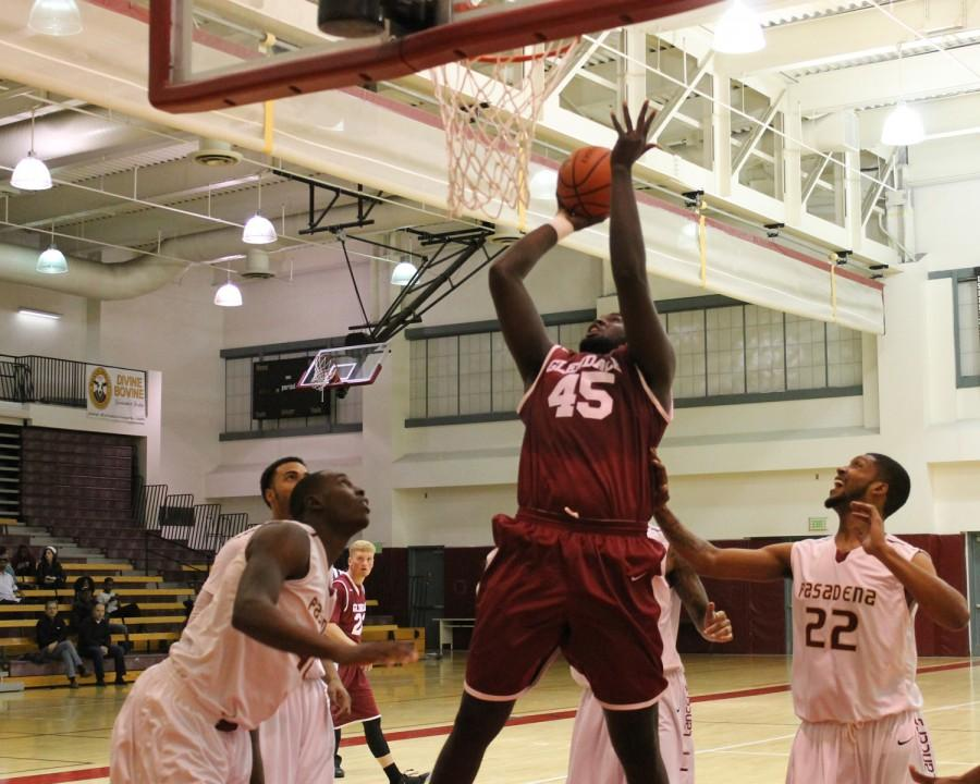 EYES ON THE PRIZE: Ange-Michel Kuo takes it to the rim uncontested at Pasadena City College.