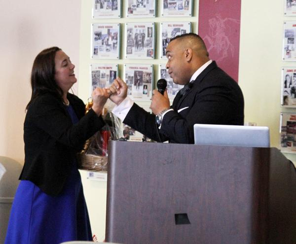 "PINKY PROMISE: After sharing her story behind the Freedom Writers Foundation, keynote speaker, Erin Gruwell, locks pinkies with Robert Hill, dean of student services, and promises to be part of the Glendale College family forever. Gruwell calls the pinky promise  a ""binding contract."""