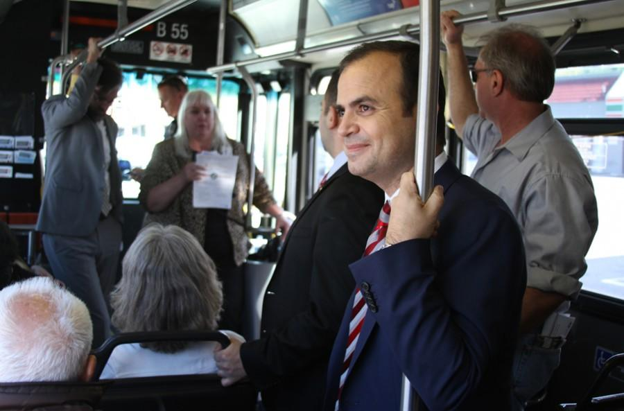 HOLD ON TIGHT: Council member Zareh Sinanyan enjoys a ride on the Glendale Beeline's route two bus during a tour of the city's public transporation amenities for Work Boot Tuesday's March meeting.