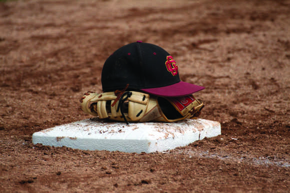 IT'S ALL OVER: A Vaquero placed his hat and glove on first base after losing to Fullerton College in the first round of the SoCal Regional playoffs.