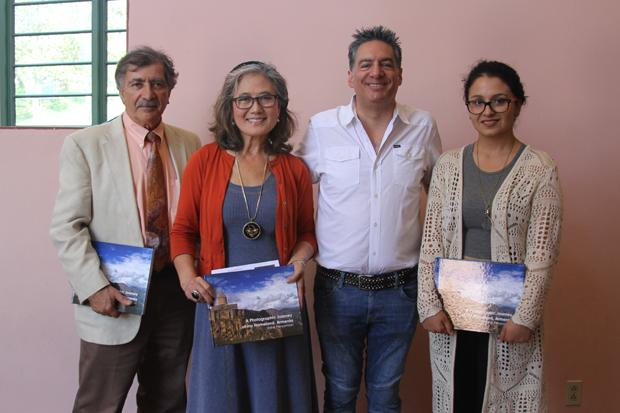 "CULTURAL DIVERSITY: Professors Levon Marashlian and J.C. Moore, author Vahe Peroomian and Armenian Student Association President Astghik Hakobyan, left to right, pose with copies  of ""A Photographic Journey of my Homeland, Armenia."""