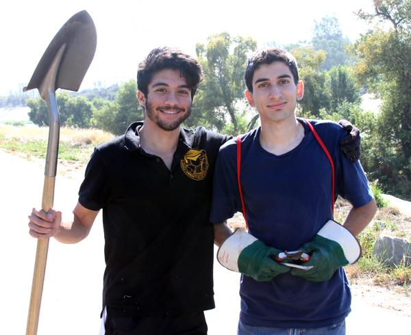 Diggin' It: Scholars club members Issa Al Hadeed and Patrick Haroutunian volunter to restore L.A. River plant life at the Glendale Narrows Riverwalk on Saturday