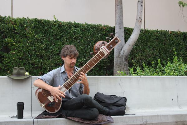 SOUNDS OF INDIA: Evan Hatfield performs on the sitar.