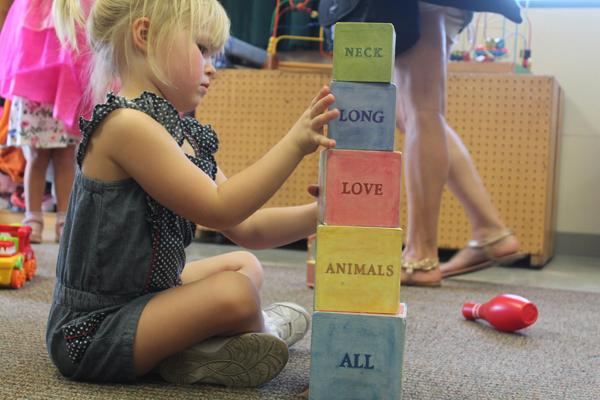 Olivia Rogerson plays with building blocks at the Child Development Center in Glendale, Calif, on Monday, Sept. 26, 2016. She enjoys stacking the blocks and creating silly sentences. (Tess Horowitz/J110)