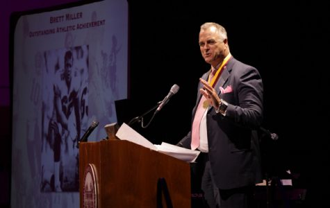 OUTSTANDING: GCC alumni and 10-year NFL veteran Brett Miller receives the Outstanding Athletic Achievement Award Saturday at the induction ceremony.