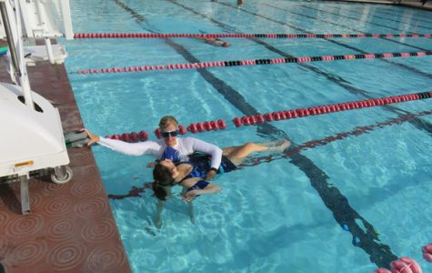 AFLOAT: Dr. Lee Parks supports student Zoe Johnson during their adapted aquatics class at the Rose Bowl Aquatics Center in Pasadena.