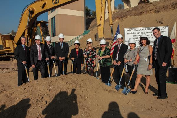 BREAKING GROUND: College dignitaries and city officials donned hard hats, and grabbed shovels at the ground breaking for the Sierra Vista building on Oct. 21, 2013. Now more than three years later, the structure is still not complete.