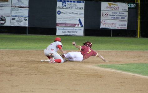 HE'S SAFE: Outfielder Christian Montes slides safely into second on an RBI double in the first inning of the March 1 game against Bakersfield at Stengel Field.