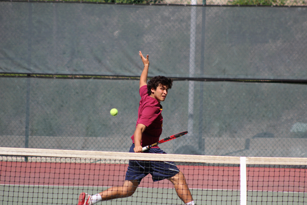 SINGLES STAR: Christian Hess in a pickup game against the New Mexico Military academy at GCC on March 15.