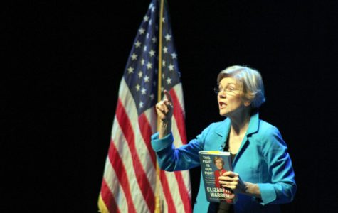 Warren Promotes Progressive Government