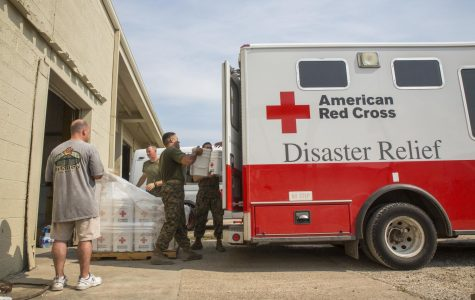 Marines from 14th Marine Regiment, 4th Marine Division, Marine Forces Reserve, load buckets of Red Cross cleaning supplies onto an American Red Cross Disaster Relief Van at Red Cross warehouse in Beaumont, Texas, Sept. 3, 2017.