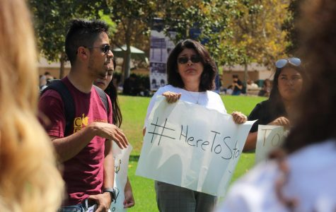 Glendale Community College students and faculty members gather in the school's central quad to protest Donald Trump's decision to end DACA.