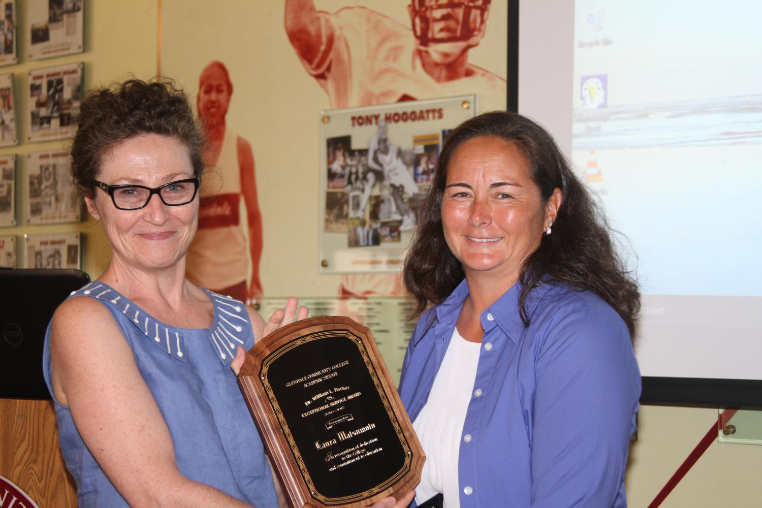 Soccer Coach Laura Matsumoto was presented with the William L. Parker award by English professor and Senate Academic President Piper Rooney.