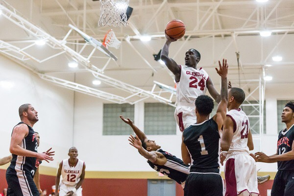 Serigne Athj, No. 24, finishes through contact against Pierce Colleges team.