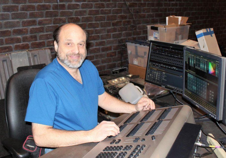 Guido+Girardi+programs+light+systems+in+the+GCC+auditorium.
