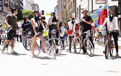 The bicycle group of radical feminists take action during a protest in East Los Angeles.
