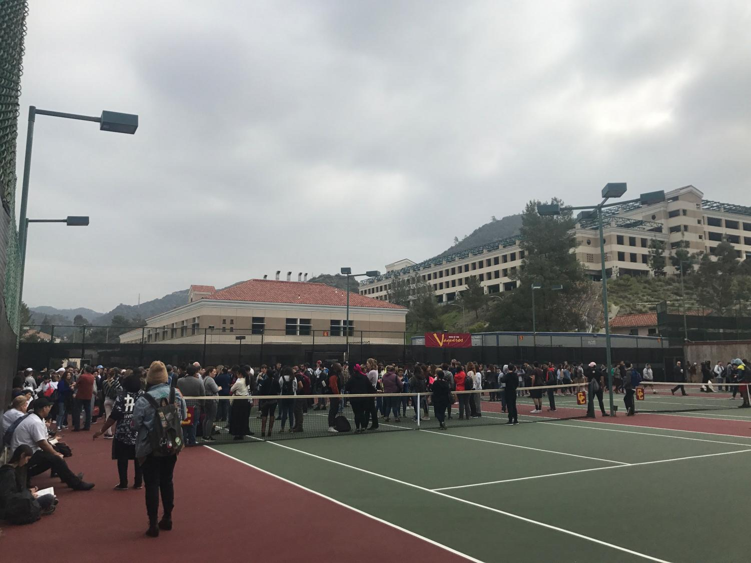 Students, staff and faculty gather at the GCC tennis court as part of the emergency fire drill on April 3.
