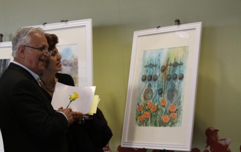 A couple appreciate Elahe Zare's are on display during GCC's Norooz celebration in the Student Center.