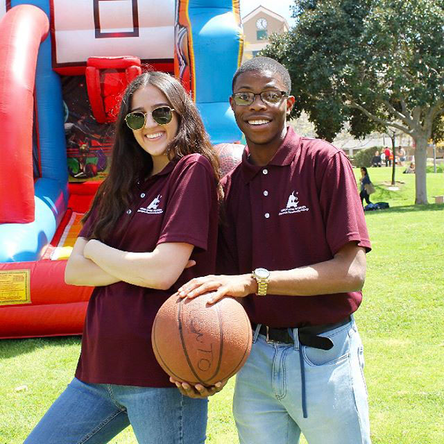 Melanie Kasparian and Joshua McCall prepare to shoot hoops in one of the activities planned for the day.