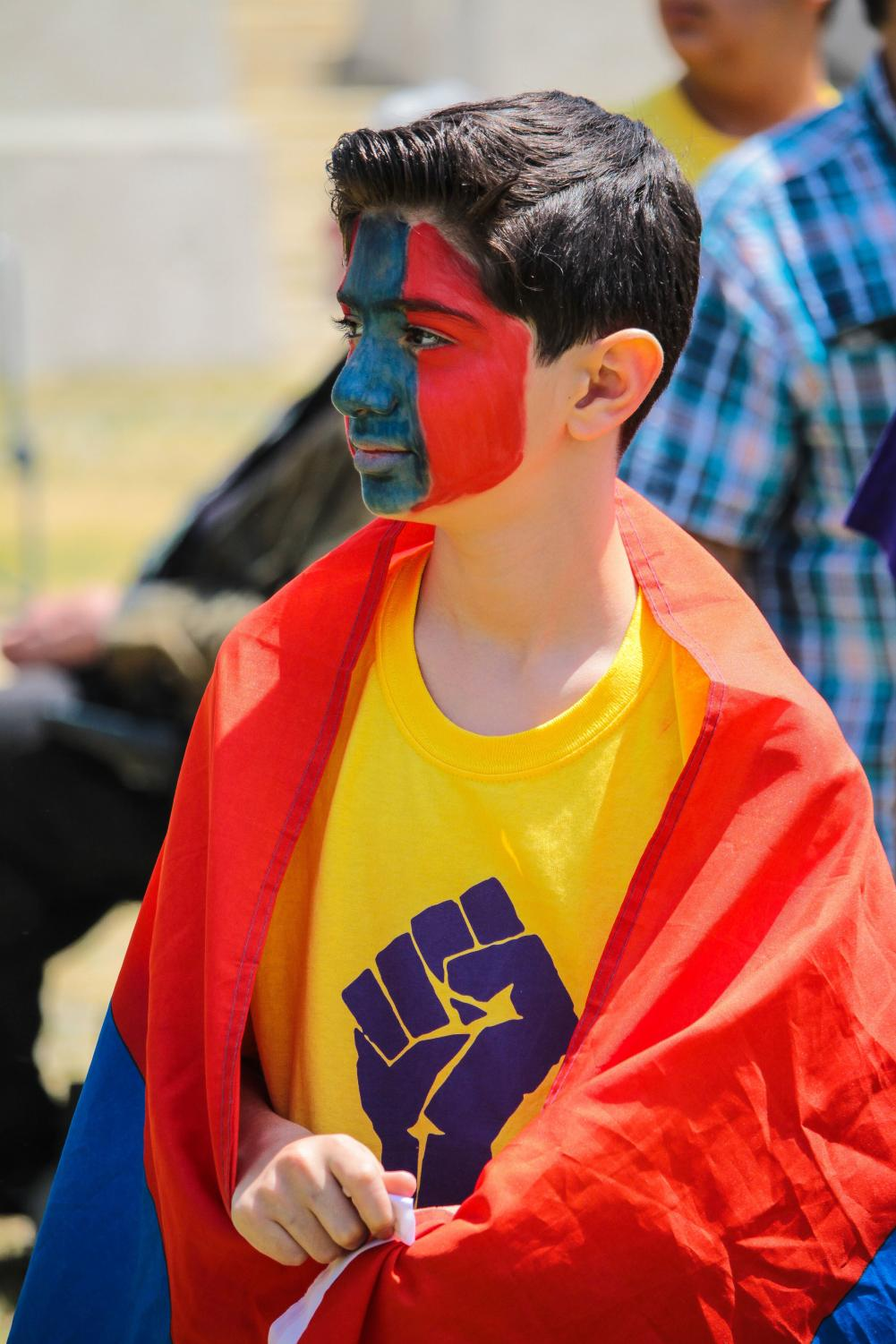 David Serobyan, 13-years-old, looks toward the crowd of protesters at the 103rd anniversary of the Armenian genocide.