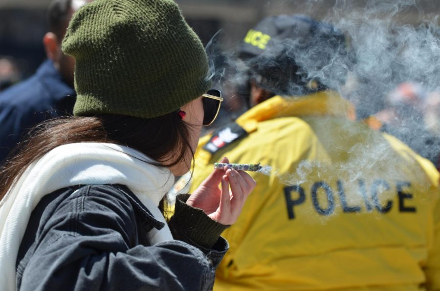 A woman hold a marijuana joint in Nathan Philips Square, in Toronto, Canada on April 20, 2018.