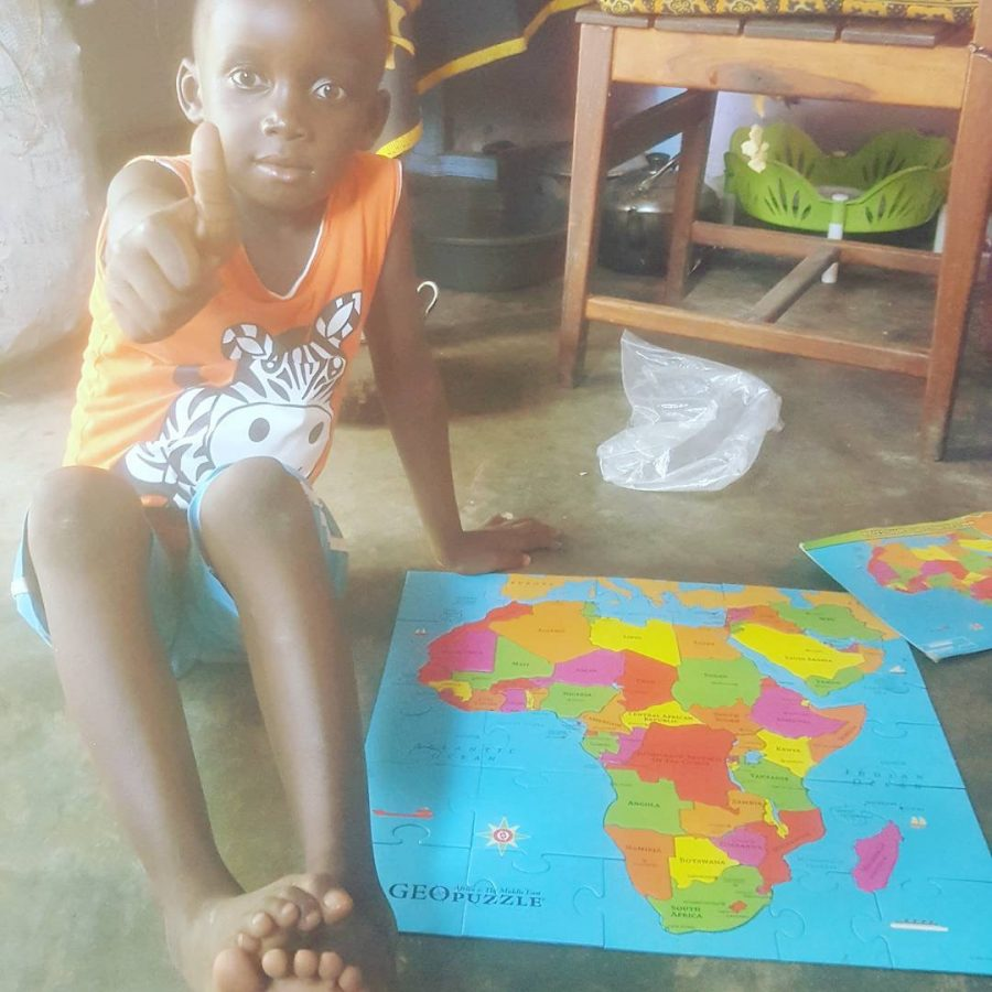 Martinez' neighbor completes a puzzle of Africa.