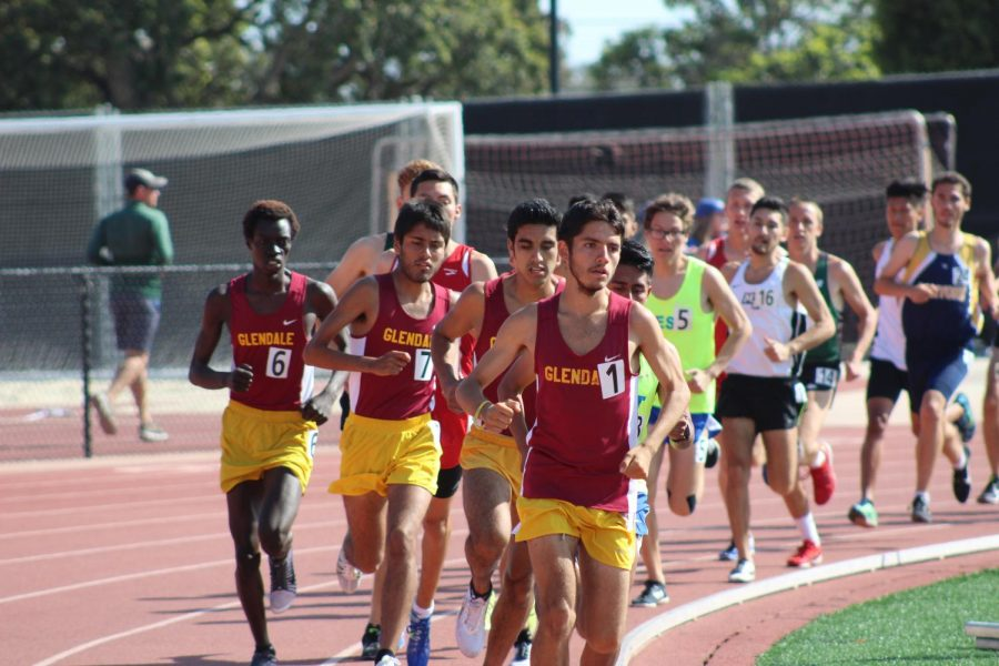 Glendale distance runners Raymond Lopez (far right), Marcelo Ramirez (middle right), Antonio Arroyo (middle left), and Akol Malong all scored points in the men's 5,000-meter run.
