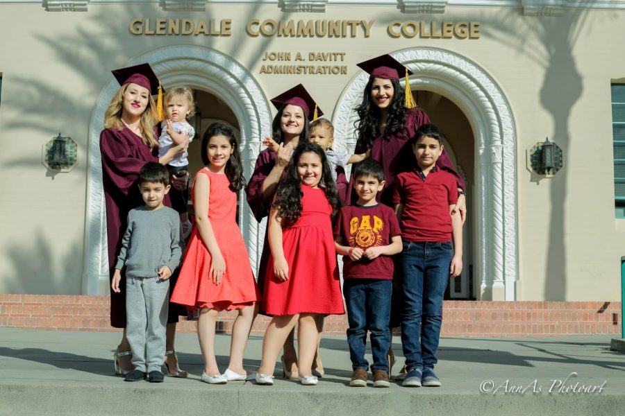 Three graduating mothers pose with their kids. From left to right: Tamara Gregoryan, Armine Sahakyan, and Anna Sargsyan.