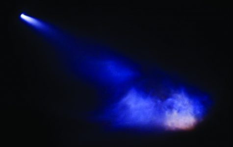 The SpaceX Falcon 9 rocket brightens up the dark sky as multiple engines burn upon landing.