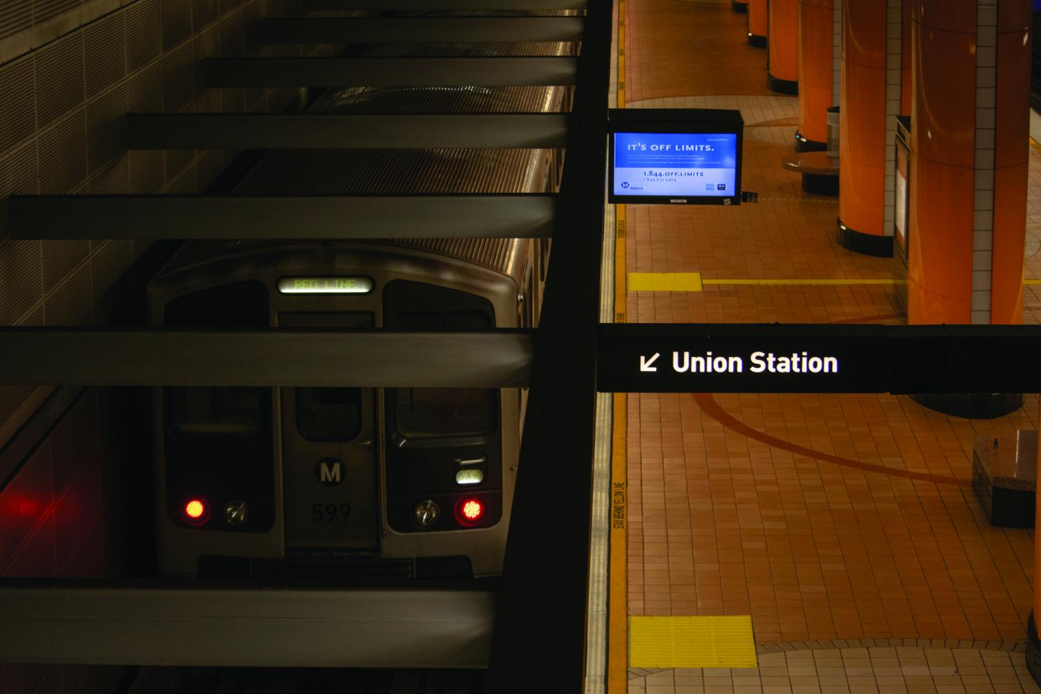 A warning about sexual harassment looms overhead as the popular commuter train with connections to Hollywood and Downtown Los Angeles, arrives at a station.