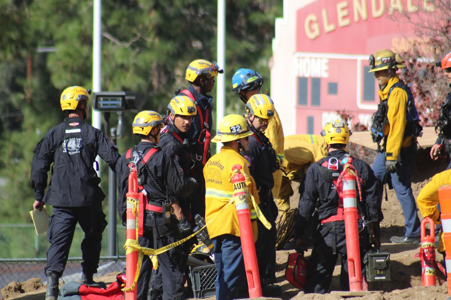 Paramedics and fire officials give medical attention to injured workers on Nov. 15.