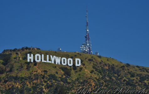 HOLLYWOOD SIGN:  The  Hollywood Sign (formerly the Hollywoodland Sign) is a landmark and American cultural icon located in Los Angeles, California. It is situated on Mount Lee in the Hollywood Hills area of the Santa Monica Mountains.