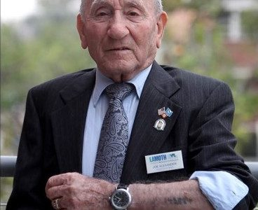 SURVIVOR: Nazi concentration camp survivor Joseph Alexander, shows his camp tattoo. He spoke to Glendale Comuunitvy College on Monday, May 13, 2019. Alexander had an open discussion with the stu- dents and staff about his experince at a dozen camps. Authentic docu- ments showing his story are on dis- play at the Los Angeles Museum of the Holocaust (LAMOTH) located in the Grove. Visit www.lamoth.org.