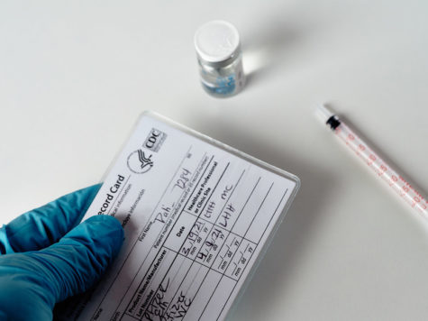 A COVID vaccination card in a medical clinic.